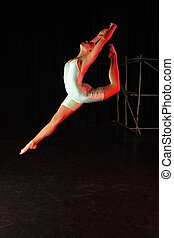Dancer on Stage - Single female modern dancer during dance...