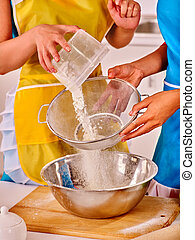 Female hands baking cookies in kitchen - Female hands baking...