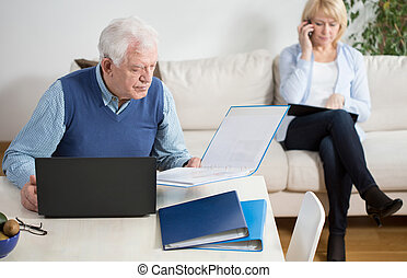 Working at home - Elder couple spending their time on work