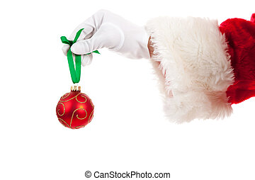 Santa\'s hand holding a red Christmas ornament
