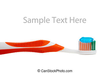 orange toothbrush and toothpaste on white