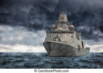 Warship - The military ship on sea against heavy clouds