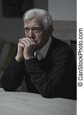 Old man praying - Old man sitting at the table and praying