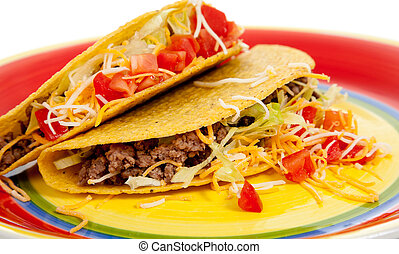 Two tacos on a plate on a white background