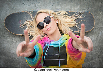 Skater Girl Peace Sign - Blond teen skater girl giving peace...