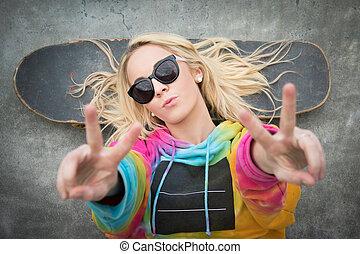 Skater Girl Peace Sign - Blond teen skater girl giving peace...