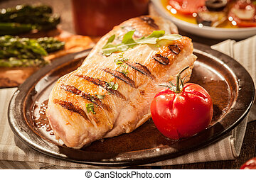 Healthy low fat grilled chicken breasts seasoned with fresh...
