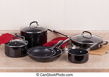 Kitchen Cookware Set - Set of black aluminum cookware on a...