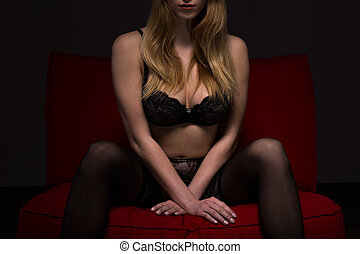 Woman sitting provocative - Photo of sexy young woman in...