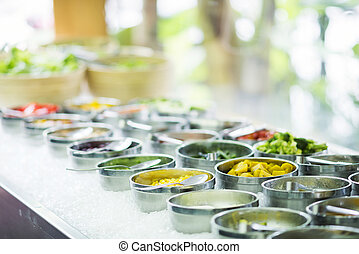 mixed vegetable ingredients in salad bar display - mixed...