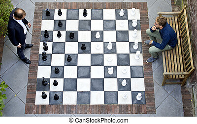 Two men playing a game of outdoor chess