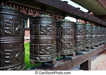 line of religious prayer wheels