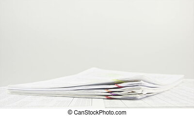 Stack paperwork on table time lapse - Stack paperwork of...