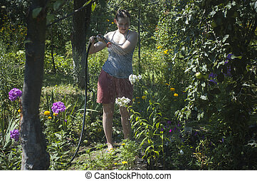 girl watering the plants