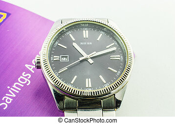 Wrist watch on book bank background image
