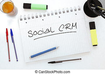 Social CRM - handwritten text in a notebook on a desk - 3d...
