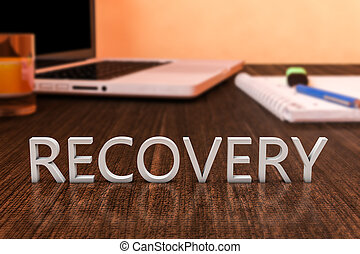 Recovery - letters on wooden desk with laptop computer and a...