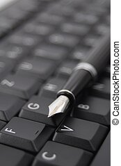 pen and keyboard - pan and black computer keyboard showing...