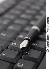 pen and keyboard - pan and black computer keyboard showing...