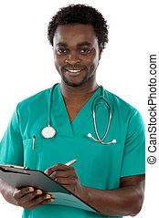 Young black doctor writing a over white background