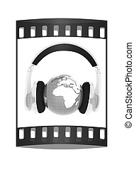 Blue earth with headphones from transparent plastic. World music concept. The film strip