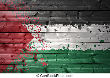 painted palestinian flag on a wooden texture - colorful...