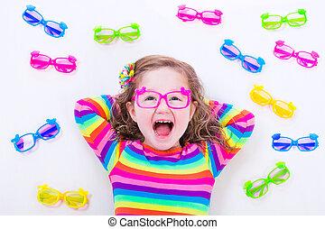 Little girl wearing eyeglasses - Child wearing eye glasses....