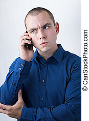 Business man making a call with serious face expression