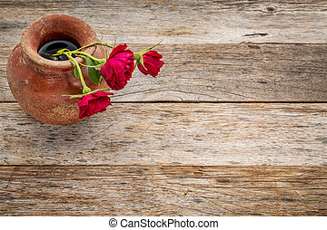 red roses against rustic wood