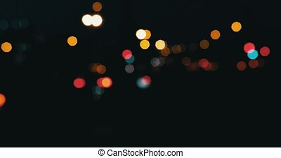 Cars in the night defocused Blurred street lights flickering...