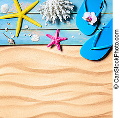 flip-flop, starfish, seashells and coral on wooden and sand...