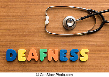 deafness colorful medical word and stethoscope on the wooden...