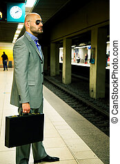 Business Man in Metro Station Waiting for Train