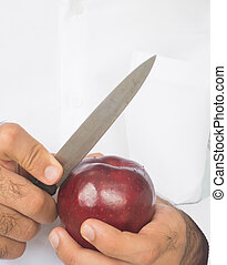 hand peeling or cutting apple - hand that peeling or cutting...