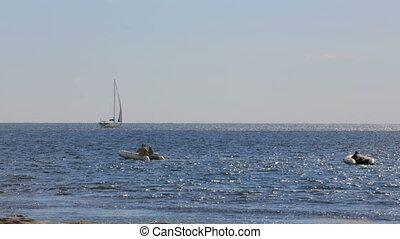 Two Boats And Yacht Sailing In The Sea - In the frame there...