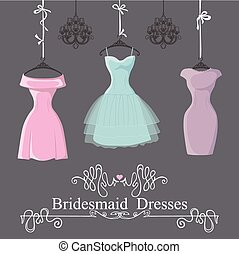 Three short bridesmaid dresses hang on ribbons - The...