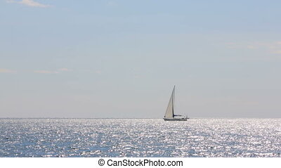 Sailboat Slowly Floating In The Sea - Full frame shot of a...