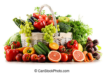 Organic vegetables and fruits in wicker basket isolated on...