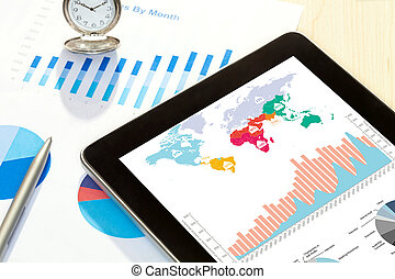 digital tablet and smartphone with financial chart report,...
