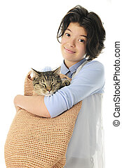 Young Teen with Her Cat in a Bag - An attractive young teen...