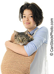 Happy with Cat in the Bag - A young teen girl happily...