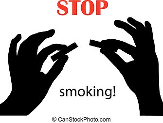 Stop smoking - silhouette of hands breaking a cigarette on a...