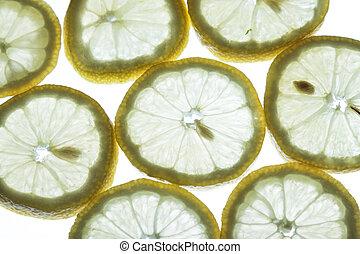 back lit lemon - back lit fresh organic lemon slices...