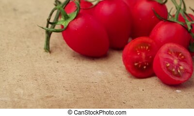Cherry tomatoes on stone background