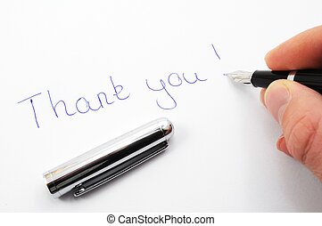 thank you message on paper with pen
