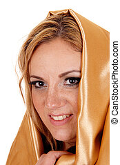 Woman with gold fabric on head - A young blond pretty woman...