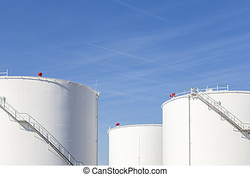 white tanks in tank farm with iron staircase - white tanks...