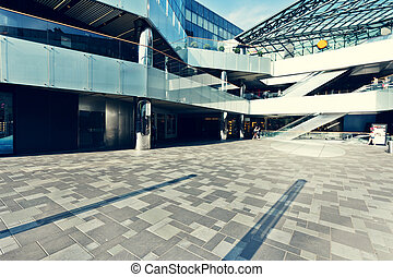 modern shopping mall exterior and empty square