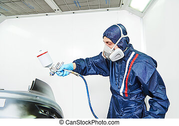 car painting in chamber - worker painting auto car bumper in...