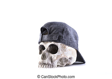 isolated human skull and cloth-cap on the white